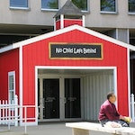 The symbolic No Child Left Behind schoolhouse was removed in June