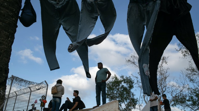 Clothes dry at a camp for asylum seekers in Matamoros, Mexico