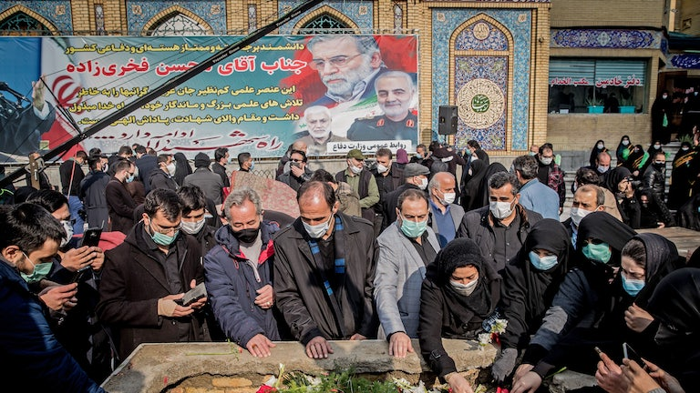 Iranian mourners attend the burial ceremony of nuclear scientist Mohsen Fakhrizadeh.