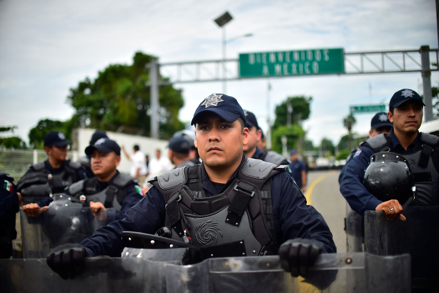 Mexican Federal Police officers get ready for the arrival of a caravan of Honduran migrants heading to the U.S.
